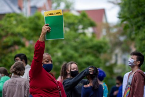 Shauna Anderson, math teacher, holds a green card to signify all her students are present for the historic campuss  full-capacity fire drill on Sept. 22.