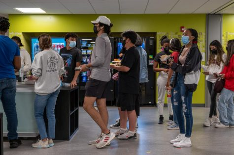 Students stand in the cafeteria line during their lunch period. Those who use their MealTime account checkout quicker compared to students who use credit cards.