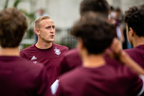 Soccer coach Josh Potter speaks to his team during a practice on Sept. 21. Mr. Potter recently received two awards from his alma mater.