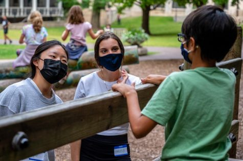 Senior Sophie Levitt and junior Myra Malkic interact with a student during Extended Day, a program that offers child-care during before and after school hours for Nursery 3 through eighth grade students.