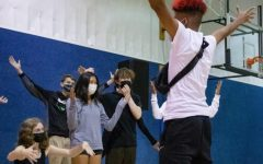 Peer leader Linsbert Reynolds creates a skit with his advisory during sophomore retreat, which began Sept. 29.