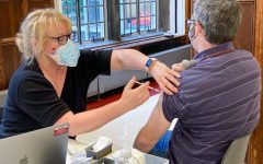English teacher Colin Rennert-May receives his booster shot during an on-site COVID-19 vaccine clinic Oct. 15.