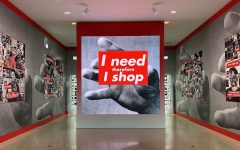 Barbara Kruger's art exhibit at the Art Institute of Chicago is filled with oversized instillations of text-heavy graphics, photography and visuals. Visitors can walk through the room to observe the surrounding art, composed primarily of contrasting shades of gray and red.