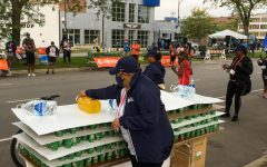 Veteran marathon runner Shauna Anderson decided this year to come volunteer on the course and cheer on runners. She passed out water and orange juice to tired athletes.