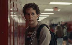 Anxiety-ridden student Evan Hansen stares off into the distance in his high schools hallway.