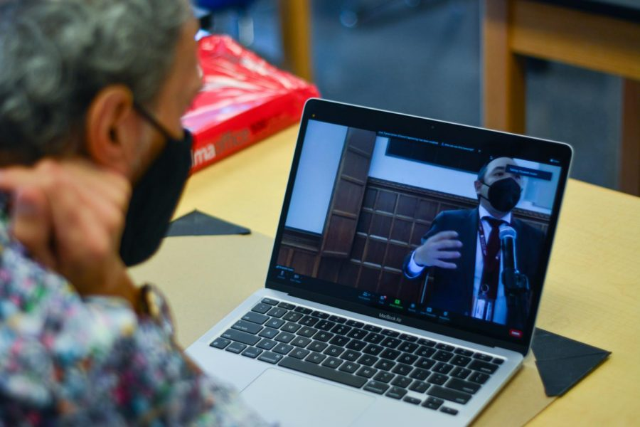 Physics teacher Javier Saez listens during a faculty meeting on Oct. 6, while Principal Paul Beekmeyer shares new homework policies.