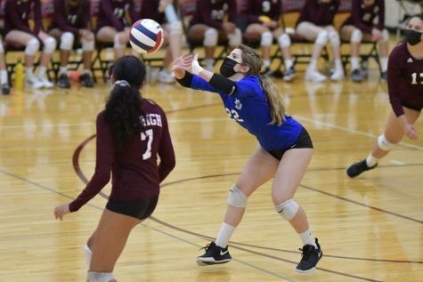Sophomore Chloe Hurst sets the ball in a game against The British School on Sept. 28.