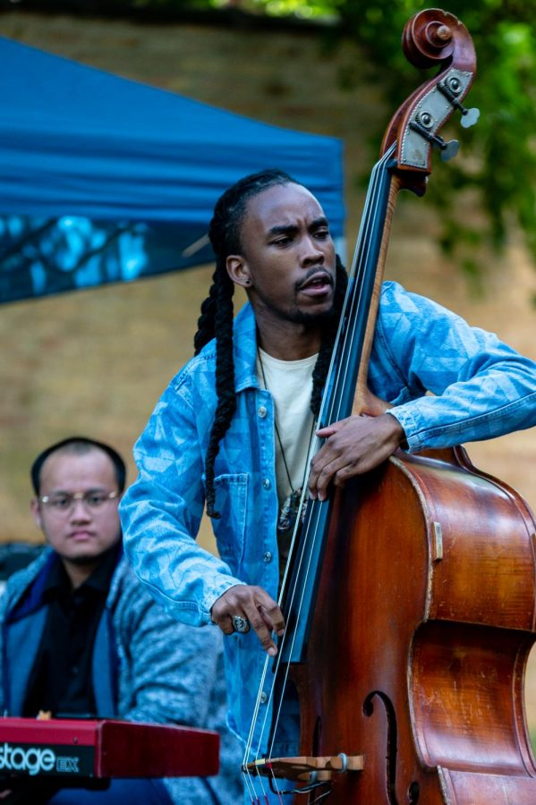 CHICAGOS FORTE. Micah Collier performs with his trio at the Augustana Lutheran Church venue. Micah played bass with Elio Adriano on the keyboard and Vincent Davis on drums. Micah was born and raised in Chicago and he is currently attending DePaul University.
