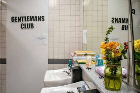 U-High's first floor boys bathroom is decorated with items such as candles, flowers and books.